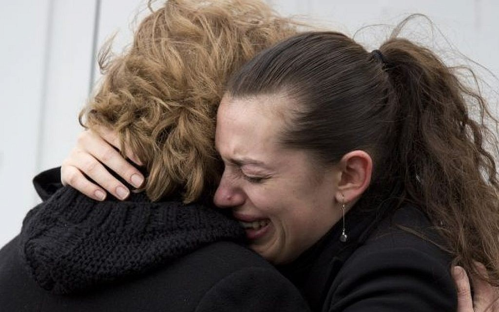 A woman cries outside a kosher grocery store, where four hostages were killed on Friday, in Paris, Saturday, Jan. 10, 2015. (photo credit: AP Photo/David Azia)