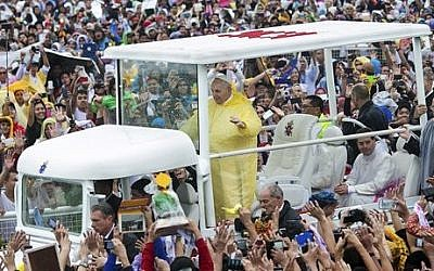 Pope Francis waves to the crowd as he arrives at Quirino Grandstand to celebrate his final Papal Mass in Manila, Philippines, Sunday, Jan. 18, 2015. (AP Photo/Ron Soliman)