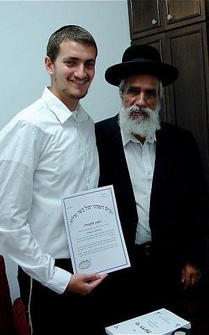 Rabbi Gabriel Negrin given his certification as mohel, or ritual circumciser, with Rabbi Shlomo Makhpud. (courtesy)