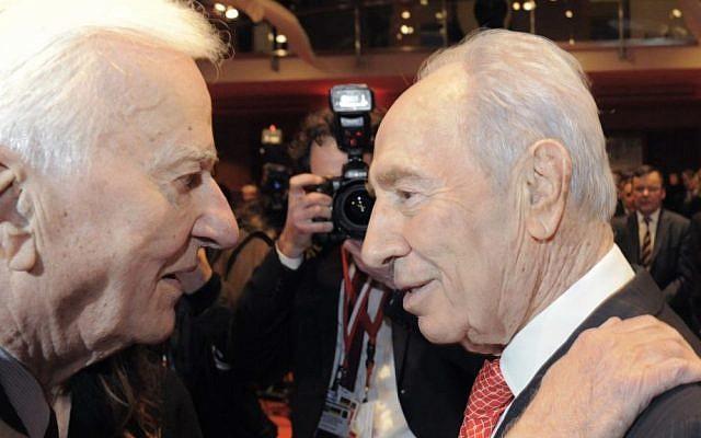 Former President of Israel Shimon Peres, right, hugs former German President Richard von Weizsaecker in Berlin, Germany on January 27, 2010 (Photo credit: Jens Meyer/AP)