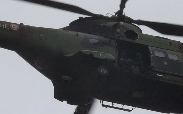 French soldiers sit in a helicopter flying over Dammartin-en-Goele where a hostage-taking was underway after police hunting the Islamist brothers who killed 12 people earlier this week exchanged fire with two men during a car chase, on January 9, 2015. (photo credit: AFP PHOTO / JOEL SAGET)