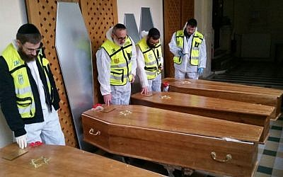 ZAKA volunteers complete their work preparing the Paris terror victims for burial and transfer to Israel, on Monday, January 12, 2015. (photo credit: ZAKA)