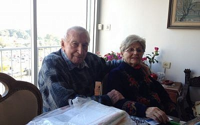 Holocaust survivors Shmuel Gabor (99) and Renee Gancz (87) in their Tel Aviv apartment, January 20, 2015. (Amanda Borschel-Dan/The Times of Israel)