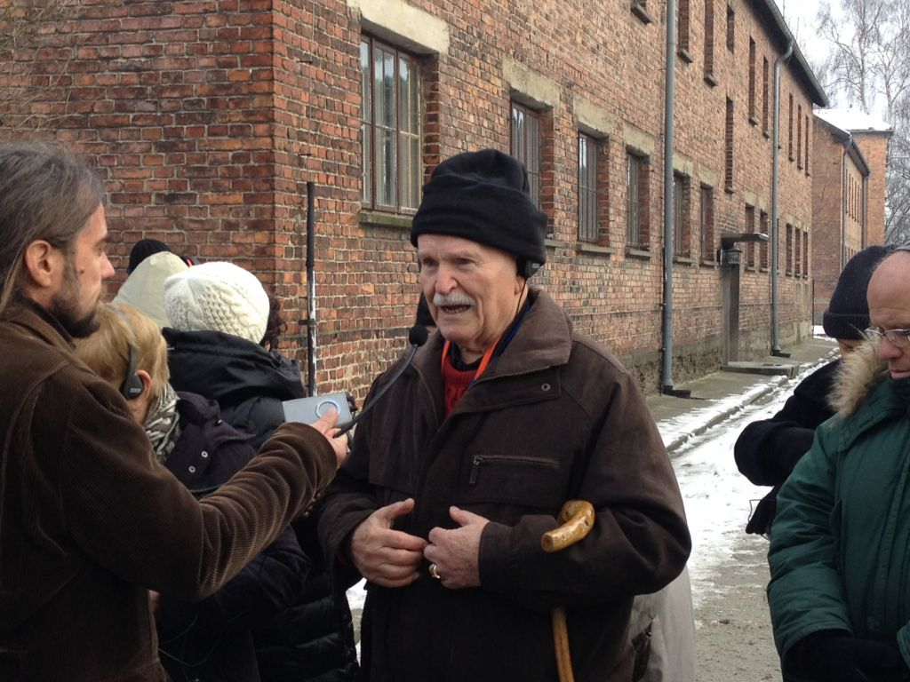 Shimon Kahan from Hod Hasharon recounts an instance in which his life was miraculously spared at Auschwitz-Birkenau on Wednesday, January 28, 2015. (Amanda Borschel-Dan/The Times of Israel)