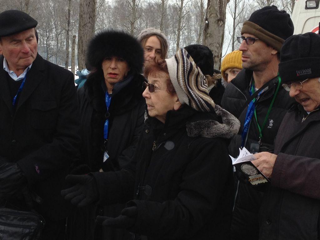 Israeli Holocaust survivor Batsheva Dagan (center), a former worker at the 'Canada' sorting center, describes the sonderkommando revolt on October 7, 1944. At far left is David Leichman, a witness to the revolt. (Amanda Borschel-Dan/The Times of Israel)