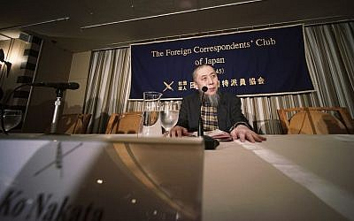 Ko Nakata, an expert on Islamic law, prepares for a press conference at the Foreign Correspondents' Club of Japan in Tokyo regarding the Islamic State, which currently holds two Japanese hostages, Thursday, Jan. 22, 2015. (AP Photo/Eugene Hoshiko)