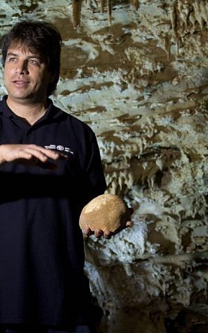 Dr. Omry Barzilai of the Israel Antiquities Authority near the site of an ancient skull fragment's discovery in the Manot Cave (photo credit: Judah Ari Gross/Times of Israel staff)
