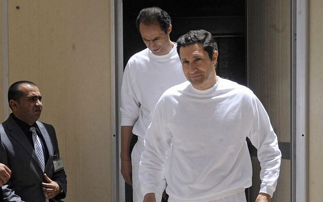 In this Saturday, June 2, 2012, photo, the two sons of ex-president Hosni Mubarak, Gamal, left, and Alaa Mubarak, right, arrive at the police academy courthouse in Cairo, Egypt. (photo credit: AP)