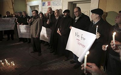 Palestinian leaders of civil society groups hold a candlelight vigil in solidarity with France outside the French Cultural Center in Gaza City, Sunday, Jan. 11, 2015. (photo credit: AP/Khalil Hamra)