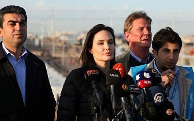 Special Envoy of the United Nations High Commissioner for Refugees (UNHCR), Angelina Jolie delivers a speech during a press conference in Khanke camp in Dahuk, north of the Kurdistan region, 260 miles (430 kilometers) northwest of Baghdad, Iraq, Sunday, Jan. 25, 2015.  (Photo credit: AP/Seivan M. Selim)