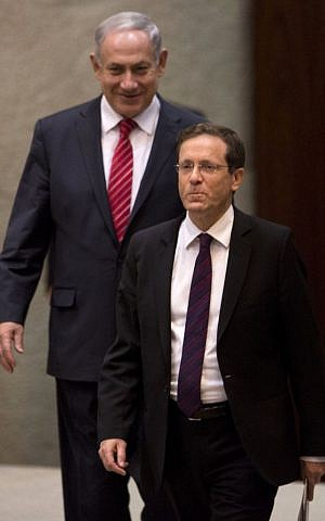 In this Monday, Jan. 20, 2014 file photo, Israel's opposition leader and Labor Party leader Isaac Herzog, front, walks past Israeli Prime Minister Benjamin Netanyahu at the Knesset, Israel's Parliament, in Jerusalem. (photo credit: AP Photo/Ariel Schalit, File)