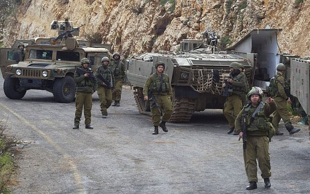Israeli soldiers secure the Israel-Lebanon border, Wednesday, January 28, 2015. (photo credit: AP/Ariel Schalit)