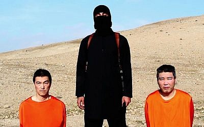 This file image taken from an online video released by the Islamic State group's al-Furqan media arm on January 20, 2015, purports to show the group threatening to kill two Japanese hostages that the militants identify as Kenji Goto (left), and Haruna Yukawa (right), unless a $200-million ransom is paid within 72 hours. (photo credit: AP/File)