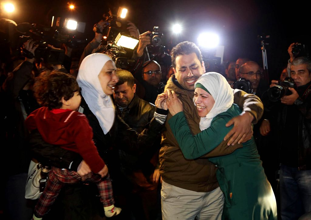 The sister, right, and wife, left, of Jordanian pilot Lt. Muath al-Kaseasbeh, who is held by the Islamic State group militants, cry at a protest in front of the Royal Palace in Amman, Jan. 28, 2015. Jordan offered a first-ever prisoner swap to the terrorist group to save al-Kaseasbeh, along with a Japanese hostage. (Photo credit: Raad Adayleh/AP)