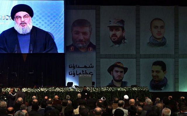 Hezbollah leader Sheikh Hassan Nasrallah speaks via video link to his supporters during a ceremony marking the death of six Hezbollah fighters and an Iranian general who were killed in an alleged Israeli airstrike in Syria's Golan Heights last week, in the southern suburb of Beirut, Lebanon, Friday, Jan. 30, 2015. (photo credit: AP Photo/Bilal Hussein)
