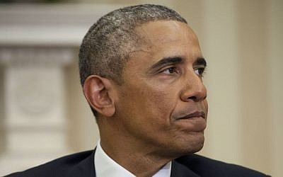 President Barack Obama pauses while speaking to members of the media, Wednesday, Jan. 7, 2015, in the Oval Office of the White House in Washington. Obama called the shootings at French newspaper a 'cowardly evil attack' on journalists and a free press. (photo credit: AP Photo/Pablo Martinez Monsivais)