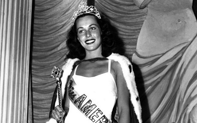 In this Sept. 8, 1945 file photo, Bess Myerson, of New York, holds the scepter after being crowned Miss America 1945 at the annual Miss America pageant in Atlantic City, N.J. Myerson, the first Jewish Miss America who parlayed her stunning 1945 victory into national celebrity, died Dec. 14, 2014, at her home in Santa Monica, Calif. She was 90. (photo credit: AP)
