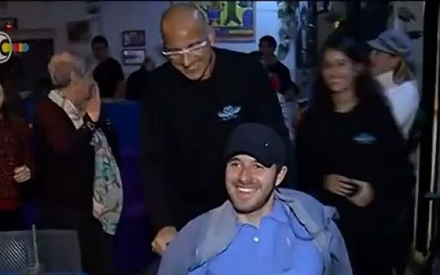 Ohad Ben Yishai pictured with his father, Shimon, at Ohad's 20th birthday celebration in Tel Aviv, November 25 2014 (screen capture: YouTube)