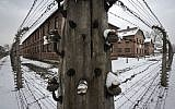 Barbed wire fences surround detention buildings at the Auschwitz Nazi death camp in Oswiecim, Poland, Monday, Jan. 26, 2015 (AP Photo/Alik Keplicz)
