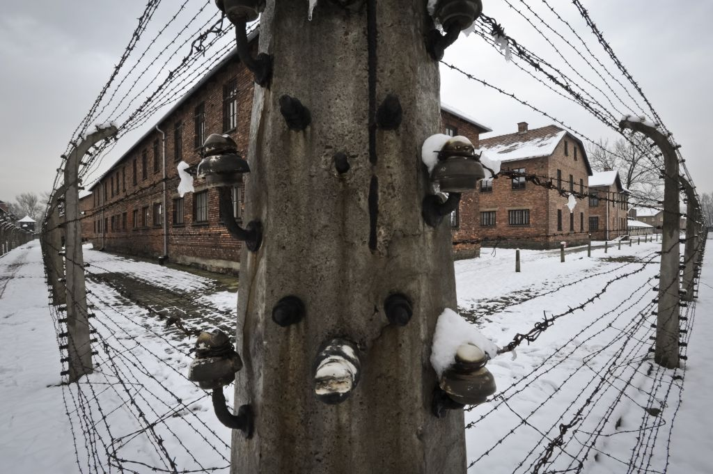 barbed wire fence concentration camp. Barbed Wire Fences Surround Detention Buildings At The Auschwitz Nazi Death Camp In Oswiecim, Poland Fence Concentration