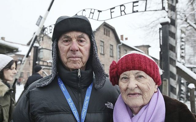 Rose Schindler, 85 (right), a survivor of Auschwitz, and her husband, Max, 85 (left), visit the former death camp in Oswiecim, Poland, on January 26, 2015 (photo credit: AP/Czarek Sokolowski)