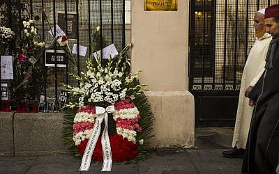 A funeral wreath left by members of the Islamic community of Madrid outside the French Embassy of Madrid in support of the Paris victims of jihadist terror attacks, Madrid, Spain, Sunday, Jan. 11, 2015.  (photo credit: AP/Andres Kudacki)