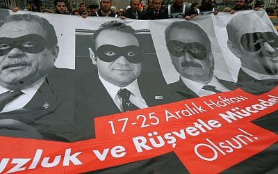 Lawmakers and officials from the main opposition Republican People's Party, CHP, carry posters with images of former Turkish ministers during a protest in Ankara, Turkey, Dec. 17, 2014. (photo credit: AP/File)