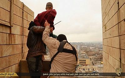 A man accused of homosexuality is led to the edge of a tall building by Islamic State fighters before being hurled down to his death in January (screenshot)