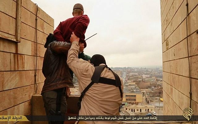 A man accused of homosexuality is led to the edge of a tall building by Islamic State fighters before being hurled down to his death (screen capture)