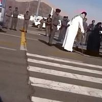 Illustrative: A woman is seen kneeling on the ground ahead of her execution in Saudi Arabi as a swordsman dressed in white stands above her, January 17, 2015. (Screen Capture: YouTube)