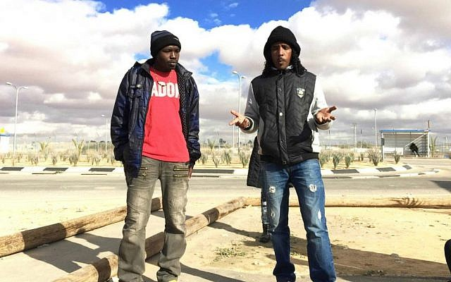 Two detainees at Holot, Adil and Tashome, tell their stories. (photo credit: Debra Kamin/Times of Israel)