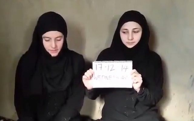 An image from a video purportedly of Italian aid workers Greta Ramelli and Vanessa Marzullo, who were abducted in August (photo credit: YouTube screenshot)