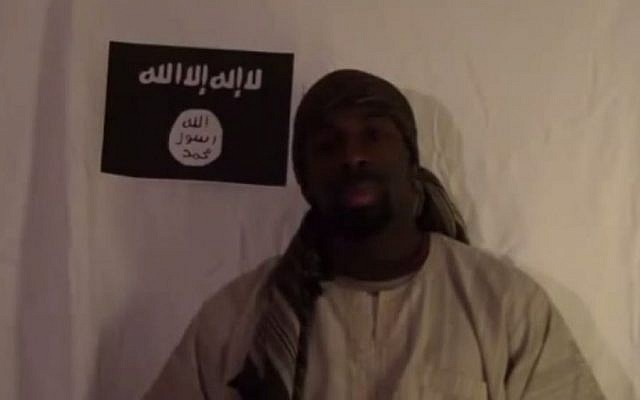 Amedy Coulibaly, who was shot dead by French police after he killed four French Jews in a kosher store on January 9, 2015, is seen in a video clip pledging allegiance to the Islamic State. (YouTube screenshot)