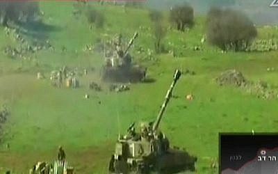 IDF artillery pieces fire into Lebanon after an attack on an Israeli border patrol, Wednesday, January 28, 2015 (screen capture: Channel 2)