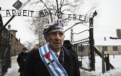 Auschwitz survivor Miroslaw Celka after paying tribute to fallen comrades at the 'death wall' execution spot in the former Auschwitz concentration camp in Oswiecim, Poland, on the 70th anniversary of the liberation of the Nazi death camp on January 27, 2015. (AFP/Odd Andersen)