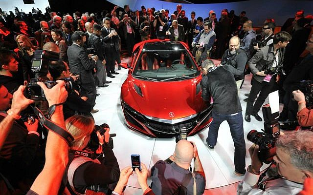 Journalists photograph the new Acura NSX vehicle at the 2015 North American International Auto Show (Photo credit: Courtesy NAIAS)