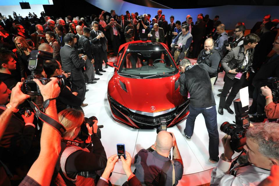 Journalists photograph the new Acura NSX vehicle at the 2015 North American International Auto Show (