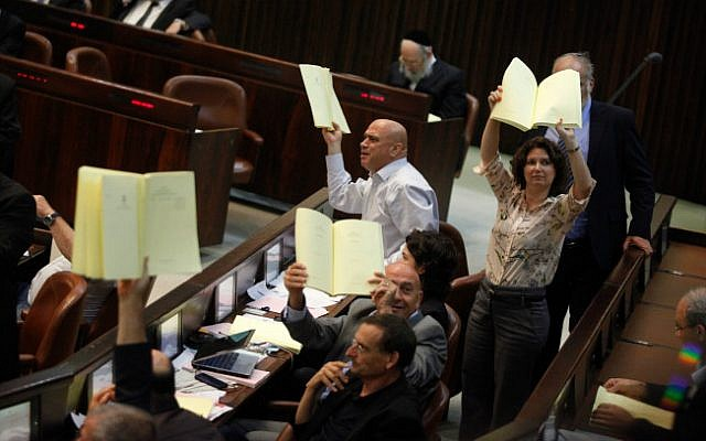 MKs form Balad and Hadash during a plenum session voting on the state budget, in the Knesset, Jerusalem, July 29, 2013 (photo credit: Flash90)