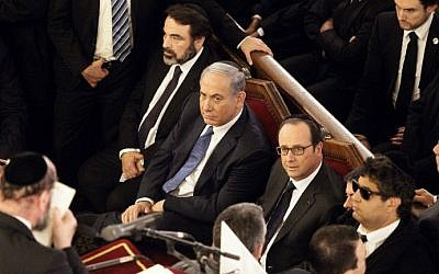 From left, The President of the Central Jewish Consistory of France, Joel Mergui, Israel's Prime Minister Benjamin Netanyahu and French President Francois Hollande attend a ceremony at the Grand Synagogue in Paris, on January 11, 2015 (photo credit: AFP/ POOL / MATTHIEU ALEXANDRE)