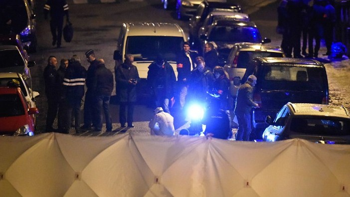 Police block Colline street in Verviers, eastern Belgium, on January 15, 2015, after two people were reportedly killed during an anti-terrorist operation (photo credit: AFP/JOHN THYS)