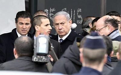 Israel's Prime Minister Benjamin Netanyahu (C) arrives at a kosher grocery store in Porte de Vincennes, eastern Paris, on January 12, 2015. (photo credit: Martin Bureau/AFP)
