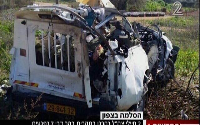An Israeli military vehicle after being hit by a Kornet anti-tank missile along the northern border on January 28, 2015. (screen capture: Channel 2)