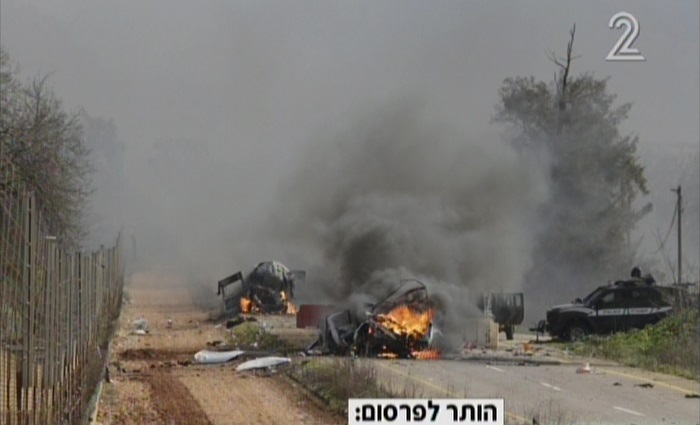 Two Israeli military vehicles seen burning after being hit in a strike claimed by Hezbollah along the Lebanese border on January 28, 2015. (Screen capture: Channel 2)