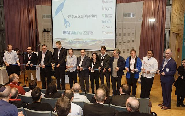 IBM executives and members of the first and second groups in the Alpha Zone Accelerator cut a blue ribbon inaugurating the second accelerator class, January 2015  (Courtesy)