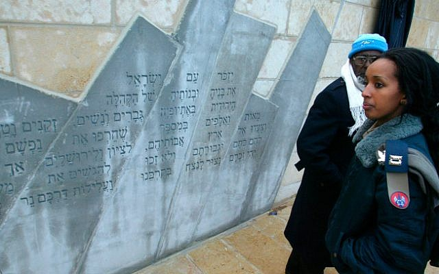 An Israel Air Force officer alongside the monument to Ethiopian Jews who died on the way to Zion, in a photo taken on March 14, 2007 (photo credit: Olivier Fitoussi/ Flash 90/ Israeli pool)