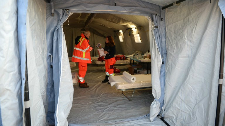Italian Red Cross volunteers set up a tents to accommodate some 500 Syrian would-be & Italy tows in migrant ship after crew abandons vessel | The Times ...
