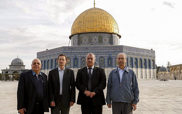 Hadash Knesset members (from left) Afu Agbaria, Dov Khenin, Mohammad Barakeh and Hana Sweid pose in front of the Done of the Rock on Jerusalem's Temple Mount, November 27, 2013. (Sliman Khader/Flash90)