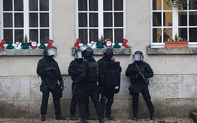 French riot officers patrol in Longpont, north of Paris, France,  January 8, 2015. (photo credit: AP/Thibault Camus)