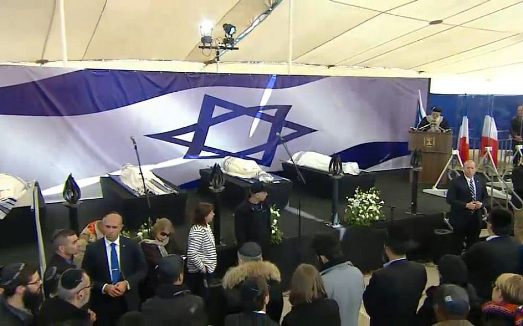 The bodies of Yoav Hattab, Philippe Braham, Yohan Cohen and Francois-Michel Saad, who were killed in an attack on a kosher supermarket in Paris, are laid out during their funeral in Jerusalem on Tuesday, January 13, 2015 (screen capture)