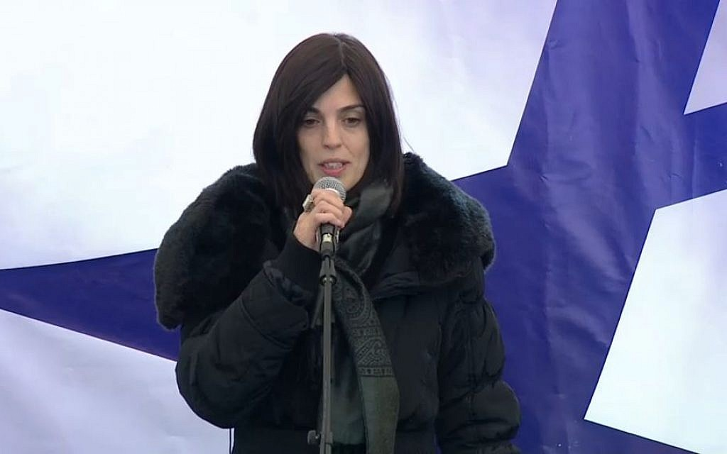 Valery Braham, widow of Philippe Braham, who was killed along with three other Jewish men in an attack in Paris, eulogizes her late husband during his funeral in Jerusalem on Tuesday, January 13, 2015 (screen capture)